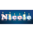 Nicole written with burning candles vector