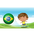 A boy beside the flag of brazil vector