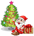 A happy santa near the christmas tree vector