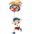 A boy holding a clown balloon vector