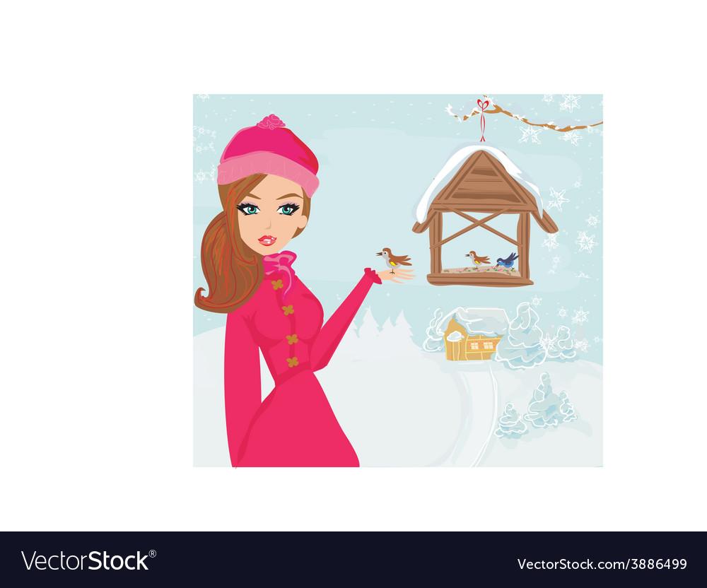 Girl feeds the birds in winter vector | Price: 1 Credit (USD $1)