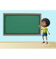 A boy near the empty blackboard vector