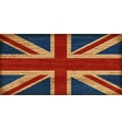 Uk flag on old wooden texture vector