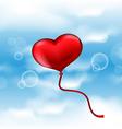 Balloon in the shape of heart on blue sky vector