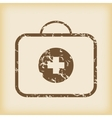 Grungy first-aid kit icon vector
