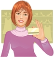 Young woman with a credit card vector