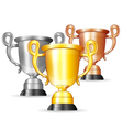 Set of gold silver and bronze trophies vector