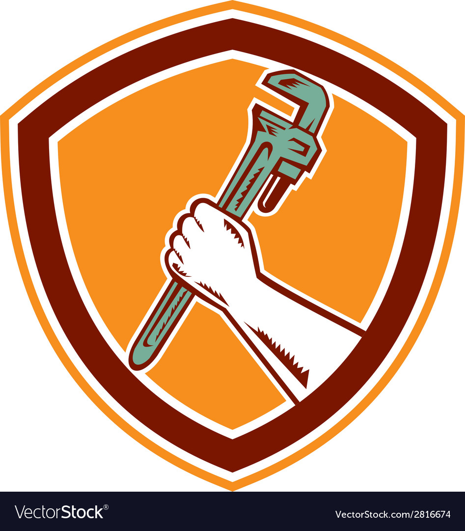 Hand holding adjustable wrench shield woodcut vector | Price: 1 Credit (USD $1)