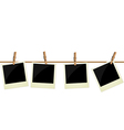 Four polaroid pictures hanging on rope vector
