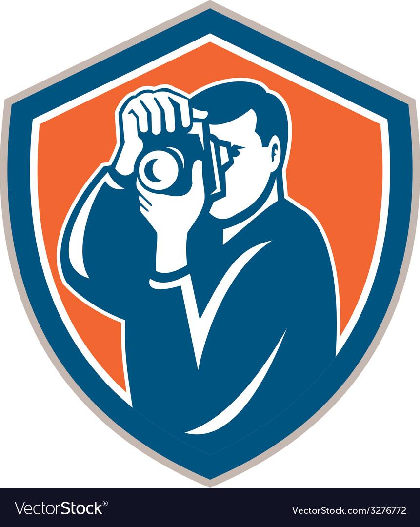 Photographer aiming camera shield retro vector   Price: 1 Credit (USD $1)