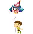 A young boy holding a clown balloon vector