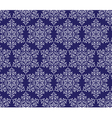 Snowflakes on a dark blue background seamless vector