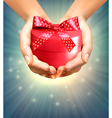 Holiday background with hands holding gift box vector