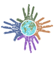 Grungy hands around the earth vector
