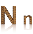 Letter n is made grains of coffee isolated on whit vector