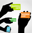 Hand holding blank business card vector