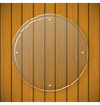 Round glass plate on the background of wooden wall vector