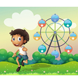 A boy in front of a ferris wheel vector