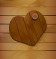 Heart on wooden background vector