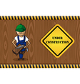 Carpenter man cartoon under construction sign vector