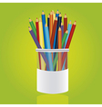 Colores pencils in pencil holders on green backgro vector