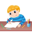 The boy draws at a table vector