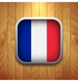 Rounded square france flag icon on wood texture vector