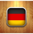 Rounded square germany flag icon on wood texture vector