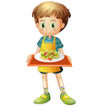 A young boy holding a tray with a plate vector
