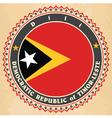 Vintage label cards of east timor flag vector