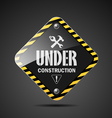 Under construction sign on black background vector