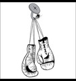 Boxing gloves hang with laces nailed to wall vector