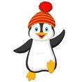 Cute penguin cartoon wearing red hat vector