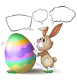 A rabbit pushing a colorful egg vector