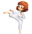 A young woman doing karate vector