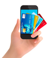 Credit cards in a phone internet banking concept vector