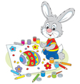 Little bunny draws an easter card vector