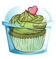 A cupcake with a green icing and a pink heart vector