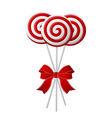 Bunch of red and white candies with red ribbon vector