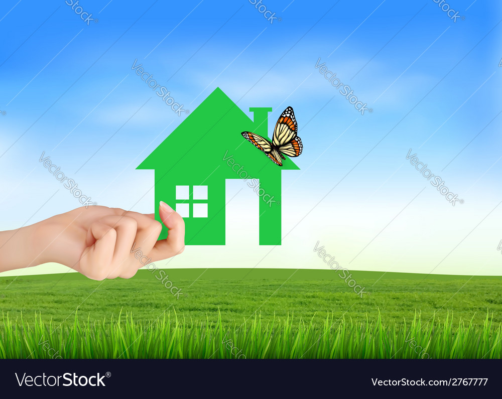 The house in hand on green natural background vector | Price: 1 Credit (USD $1)