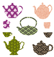 Tea pots and cups with asian pattern vector
