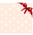 Red ribbon on snowflakes background vector