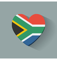 Heart-shaped icon with flag of south africa vector