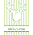 Baby arrival card with clothes vector