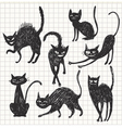Hand drawn black cats in different poses vector