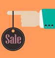 Hand holding sale label vector