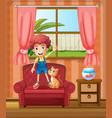 A boy standing at the sofa inside the house vector