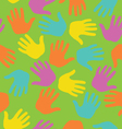 Seamless pattern with colored hand prints vector