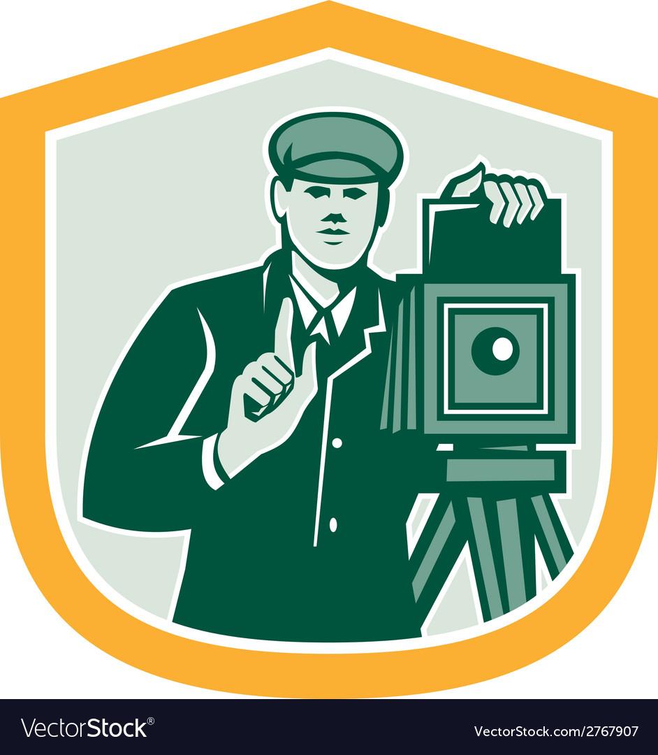 Photographer shooting vintage camera shield retro vector   Price: 1 Credit (USD $1)