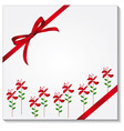 Gift box with a red bow vector